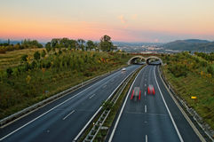 Asphalt highway with ecoduct at sunset Stock Photography