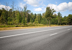 Asphalt highway in the summer Royalty Free Stock Photo