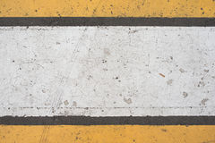 Asphalt highway texture with cracked white and yellow stripe.  Stock Photo