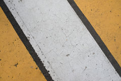 Asphalt highway texture with cracked white and yellow stripe.  Stock Image