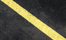 Asphalt with a marking in the background Stock Images