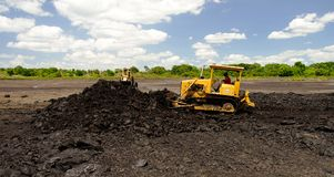 Asphalt mining in the Pitch Lake at La Brea, Trinidad and Tobago. Asphalt mining in the Pitch Lake at La Brea in Trinidad and Tobago Stock Photography