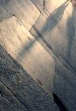 Asphalt mit menschlichen Schatten Stockfoto