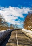 Asphalt mountain road in winter. Beautiful sunny day Royalty Free Stock Photo