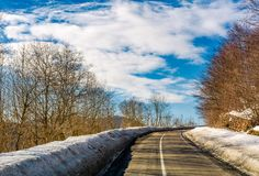 Asphalt mountain road in winter. Beautiful sunny day Royalty Free Stock Photography