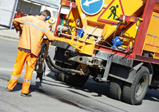 Asphalt patching roadworks Stock Photos