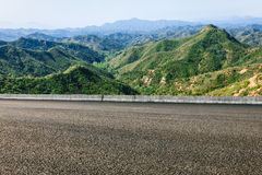 Asphalt pavement in the mountains Stock Images