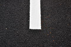 Asphalt pavement texture with a white line Stock Image