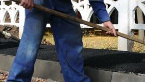 Asphalt paver applying asphalt stock video