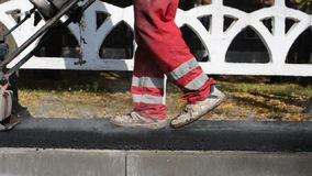 Asphalt paver applying asphalt stock footage