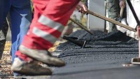 Asphalt paver applying asphalt stock video footage