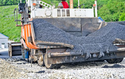 Asphalt paver machine Royalty Free Stock Photo