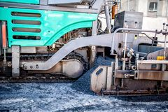 Asphalt paver machine during road construction site Stock Photo