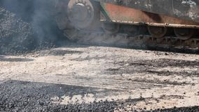 Asphalt Paver making road Stock Photos