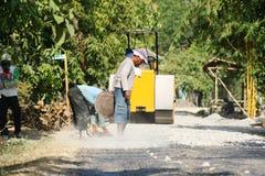 Asphalt paver repairing Royalty Free Stock Photography