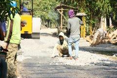 Asphalt paver repairing Royalty Free Stock Photos