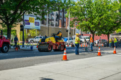 Asphalt paving crew Stock Images