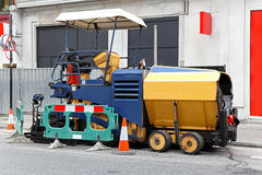 Asphalt paving machine Stock Images