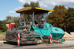Asphalt paving machine Royalty Free Stock Photo