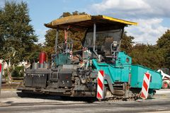 Asphalt paving machine Royalty Free Stock Photography