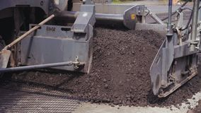 Asphalt paving machine works, road construction crew apply asphalt layer stock video