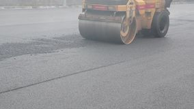 Asphalt paving. Road Construction site. Reconstruction of street. Restoration of pavement. Construction site.. Workers