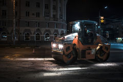 Asphalt paving with road roller. At night Stock Photography