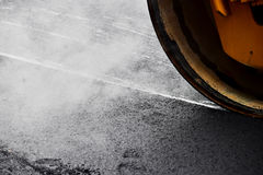 Asphalt paving with steel roller Royalty Free Stock Image