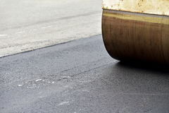Asphalt paving with a steel Royalty Free Stock Images