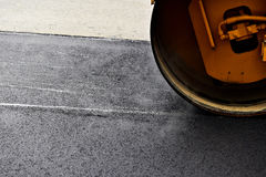 Asphalt paving with a steel wheel roller Royalty Free Stock Photo