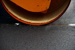 Asphalt paving with a steel wheel roller Royalty Free Stock Image