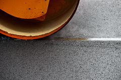 Asphalt paving with a steel wheel roller Royalty Free Stock Photography