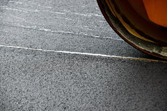 Asphalt paving with a steel wheel roller Stock Photography