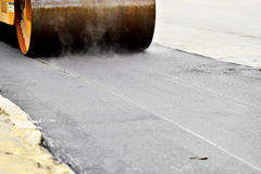 Asphalt paving with a steel wheel roller Royalty Free Stock Images