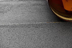 Asphalt paving with a steel wheel roller Stock Photo