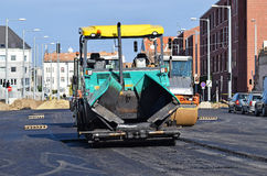 Asphalt paving vehicle at the road construction Stock Images