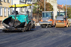 Asphalt paving vehicle and road roller Royalty Free Stock Images