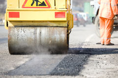 Asphalt paving works with compactor Stock Photography
