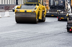 Asphalt paving works with road Stock Images