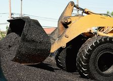 Asphalt processing Royalty Free Stock Photo