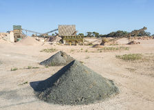 Asphalt Processing Machinery and Mounds of Waste. Stock Photo