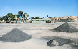 Asphalt Processing Plant and Mounds of Waste Royalty Free Stock Image