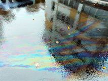 Asphalt in the rain colorful puddle royalty free stock images