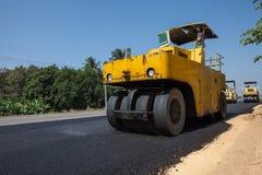 An asphalt roller. On asphalt asphalt rider there an asphalt roller to keep everything well pressed Royalty Free Stock Image