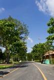 Asphalt Road. Leading to the Glass Door of Natural Public Garden Stock Photos