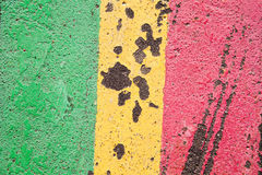 Asphalt road abstract colored lines. Green yellow red paint. Up view. Royalty Free Stock Image