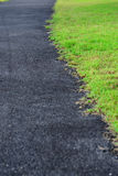 Asphalt road is along with grass Stock Image