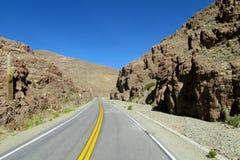 Asphalt road at altiplano canyon Stock Photo