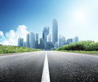 Asphalt Road And City Stock Images