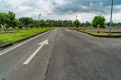 Asphalt road with arrow sign Royalty Free Stock Photography
